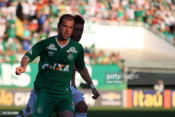 Tiago Luis of Chapecoense struggles for the ball with Souza of Santos during a match between Chapecoense and Santos for the Brazilian Series A 2014...