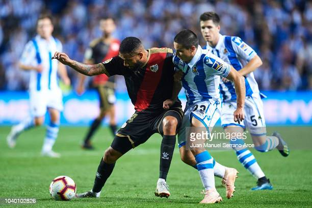 Tiago Manuel Dias Bebe of Rayo Vallecano competes for the ball with Sangalli of Real Sociedad during the La Liga match between Real Sociedad and Rayo...