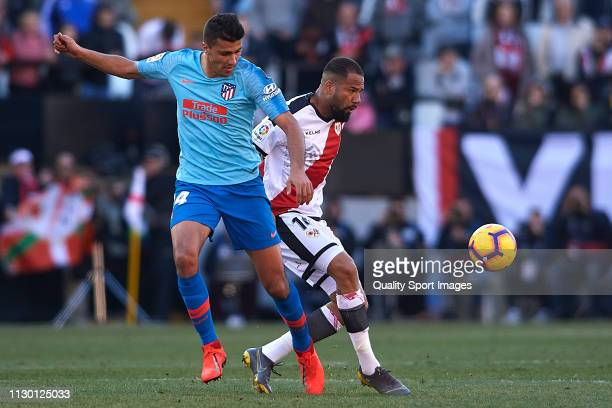 Tiago Manuel Dias 'Bebe' of Rayo Vallecano competes for the ball with Rodrigo Hernandez of Atletico de Madrid during the La Liga match between Rayo...