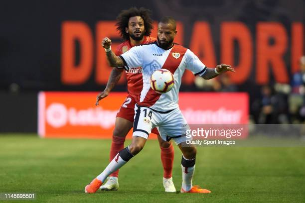 Tiago Manuel Dias 'Bebe' of Rayo Vallecano competes for the ball with Marcelo Vieira of Real Madrid during the La Liga match between Rayo Vallecano...
