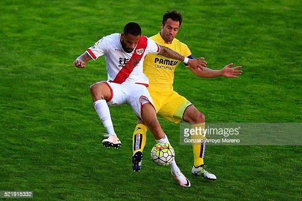 Tiago Manuel Dias Correia alias Bebe of Rayo Vallecano de Madrid competes for the ball with Mario Perez of Villarreal CF during the La Liga match...