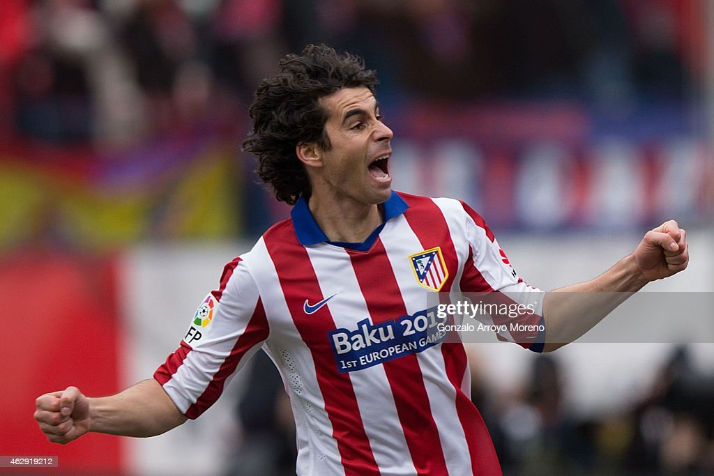 Tiago Mendes of Atletico de Madrid celebrates scoring their opening goal during the La Liga match between Club Atletico de Madrid and Real Madrid CF at Vicente Calderon Stadium on February 7, 2015 in Madrid, Spain.