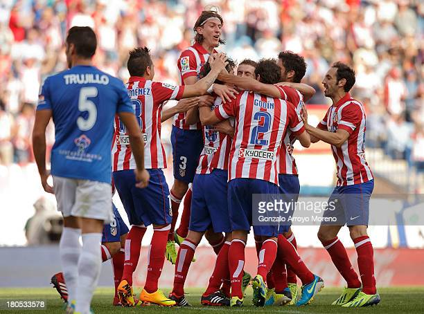 Tiago Mendes of Atletico de Madrid celebrates scoring their third goal with teammates during the La Liga match between Club Atletico de Madrid and UD...