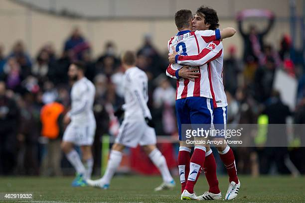 Tiago Mendes of Atletico de Madrid embraces with teammate Guilherme Madalena Siqueira celebrating their voctory after the La Liga match between Club...