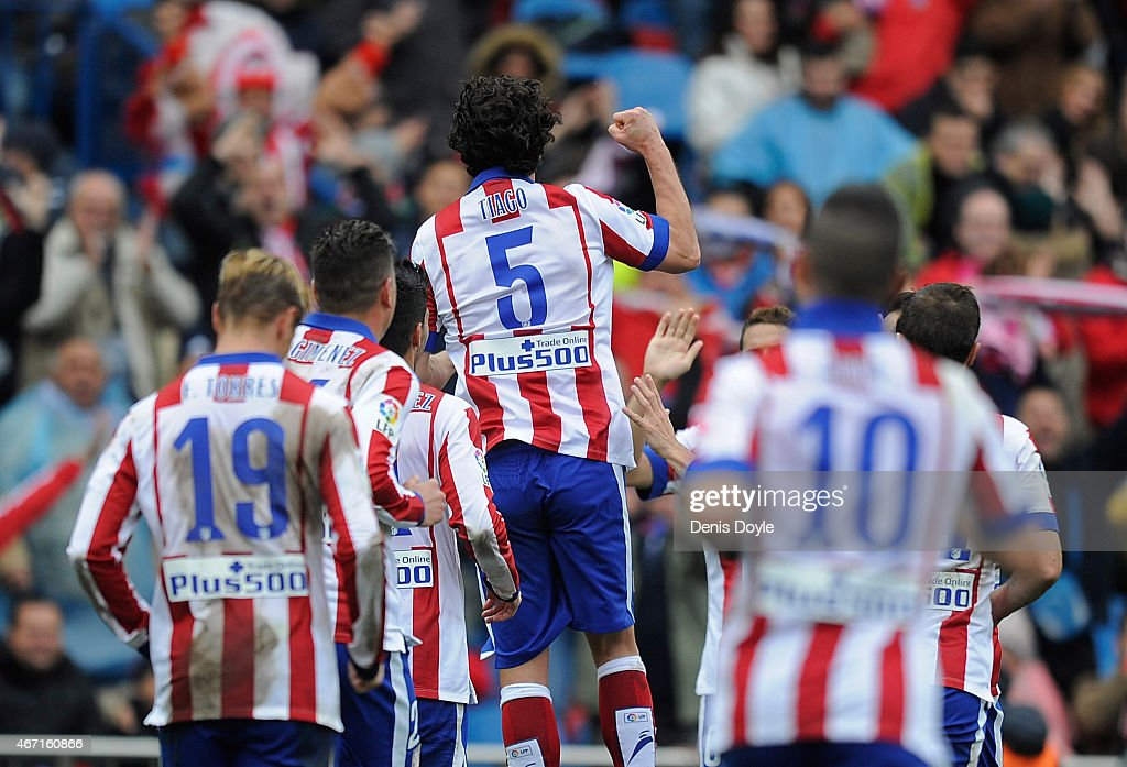 Tiago Mendes of Club Atletico de Madrid celebrates after scoring his team's 2nd goal during the La Liga match between Club Atletico de Madrid and Getafe CF at Vicente Calderon Stadium on March 21, 2015 in Madrid, Spain.