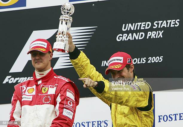 Tiago Monteiro of Portugal and Jordan celebrates his 3rd place finish while the winner Michael Schumacher of Germany and Ferrari looks on during the...