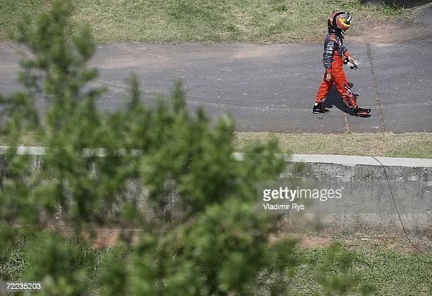 Tiago Monteiro of Portugal and Spyker MF1 Racing leaves the track after spinning with his car during the qualifying session of the Brazilian Formula...