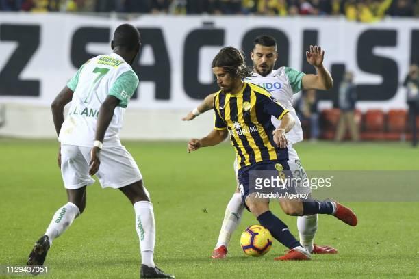 Tiago Pinto of MKE Ankaragucu in action against Aytac Kara and Allano Lima of Bursaspor during Turkish Super Lig soccer match between MKE Ankaragucu...