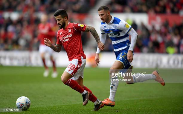 Tiago Silva of Nottingham Forest is challenged by Dominic Ball of Queens Park Rangers during the Sky Bet Championship match between Nottingham Forest...