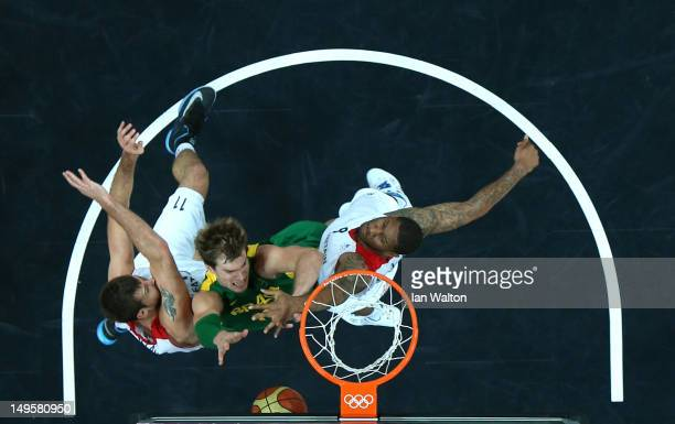 Tiago Splitter of Brazil drives to the basket in the Men's Basketball Preliminary Round match between Great Britain and Brazil on Day 4 of the London...