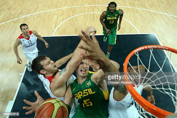 Tiago Splitter of Brazil meets traffic as he drives to the basket in the Men's Basketball Preliminary Round match between Great Britain and Brazil on...