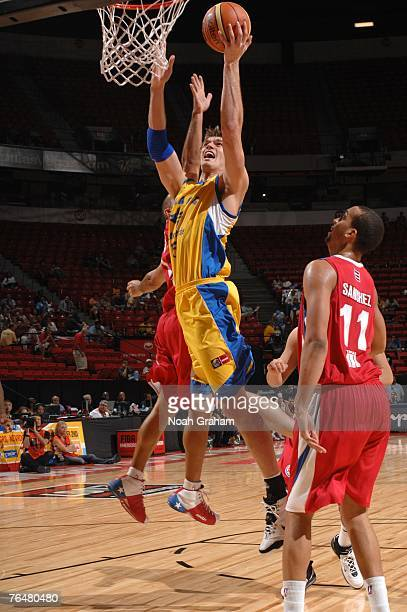 Tiago Splitter of Brazil shoots against Ricardo Sanchez of Puerto Rico during the bronze medal game of the 2007 FIBA Americas Championship at the...
