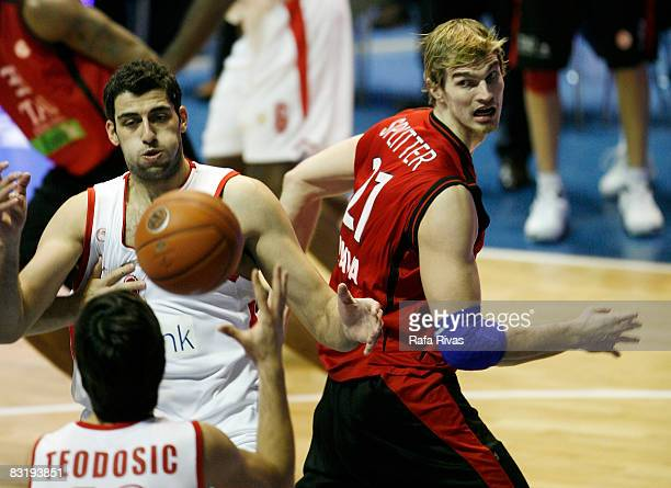 Tiago Splitter of TAU Baskonia and Ioannis Bourousis of Olympiacos in action during the Euroleague Basketball Game 8 between Tau Ceramica v...