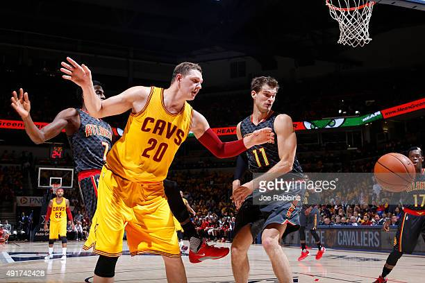 Tiago Splitter of the Atlanta Hawks battles for a rebound against Timofey Mozgov of the Cleveland Cavaliers in the first half of a preseason game at...