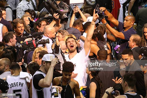 Tiago Splitter of the San Antonio Spurs celebrates winning the 2014 NBA Championship after Game Five of the 2014 NBA Finals against the Miami Heat at...
