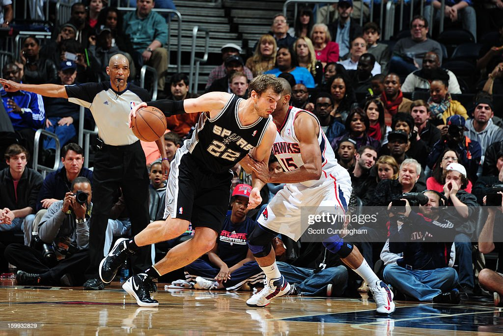 Tiago Splitter #22 of the San Antonio Spurs drives to the basket against the Atlanta Hawks on January 19, 2013 at Philips Arena in Atlanta, Georgia.
