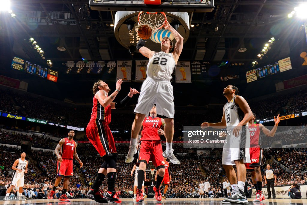 Tiago Splitter #22 of the San Antonio Spurs dunks against the Miami Heat during Game Three of the 2013 NBA Finals on June 11, 2013 at AT&T Center in San Antonio, Texas.