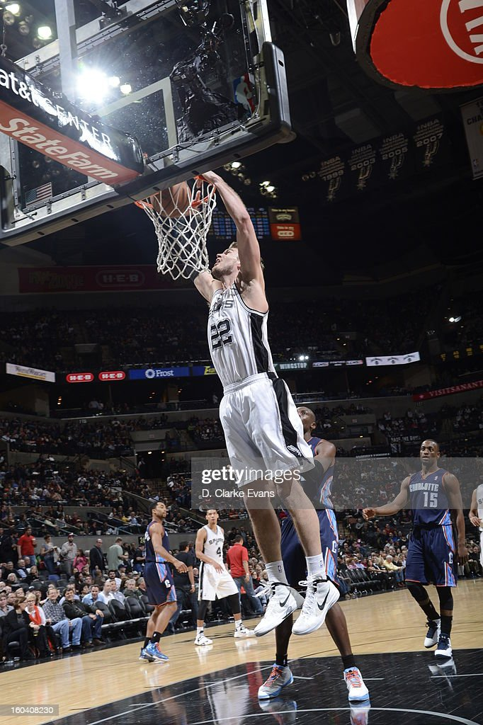Tiago Splitter #22 of the San Antonio Spurs goes in for the dunk against the Charlotte Bobcats on January 30, 2013 at the AT&T Center in San Antonio, Texas.
