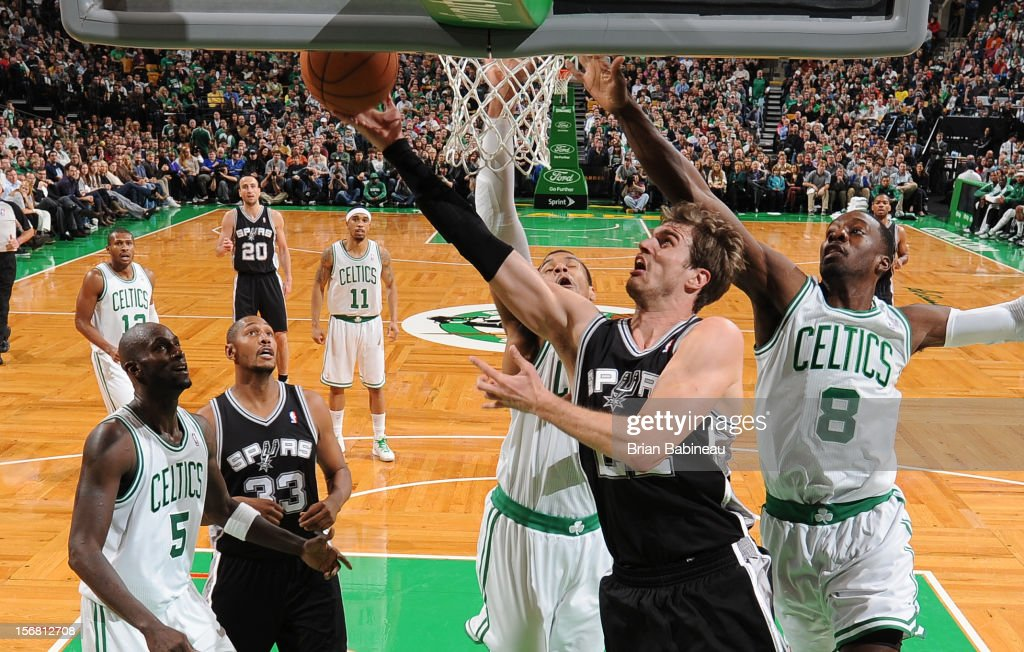 Tiago Splitter #22 of the San Antonio Spurs goes to the basket against Jeff Green #8 of the Boston Celtics on November 21, 2012 at the TD Garden in Boston, Massachusetts.
