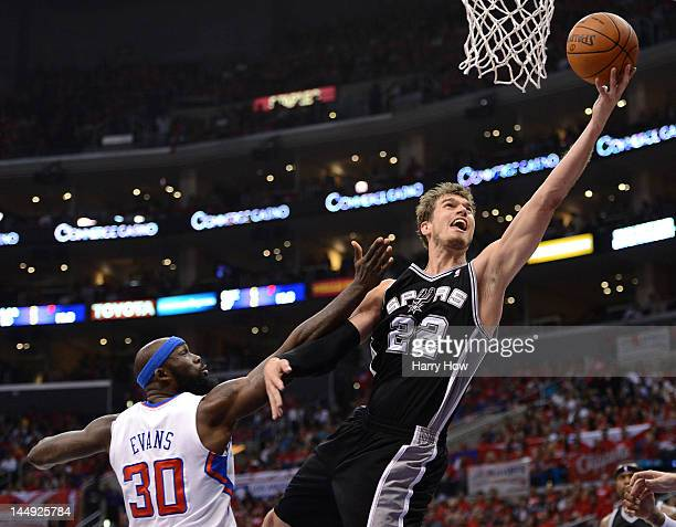 Tiago Splitter of the San Antonio Spurs goes up for a shot against Reggie Evans of the Los Angeles Clippers in the second quarter in Game Four of the...