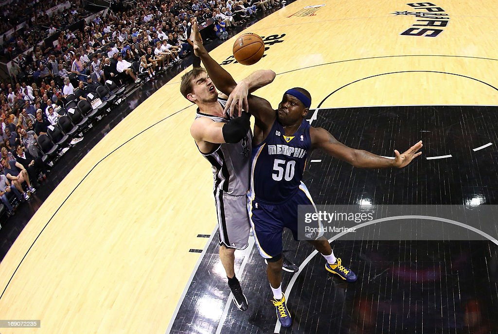 Tiago Splitter #22 of the San Antonio Spurs loses the ball in the second half as he is defended by Zach Randolph #50 of the Memphis Grizzlies during Game One of the Western Conference Finals of the 2013 NBA Playoffs at AT&T Center on May 19, 2013 in San Antonio, Texas.