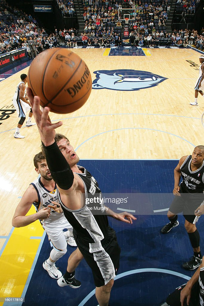 Tiago Splitter #22 of the San Antonio Spurs rebounds against the Memphis Grizzlies on January 11, 2013 at FedExForum in Memphis, Tennessee.