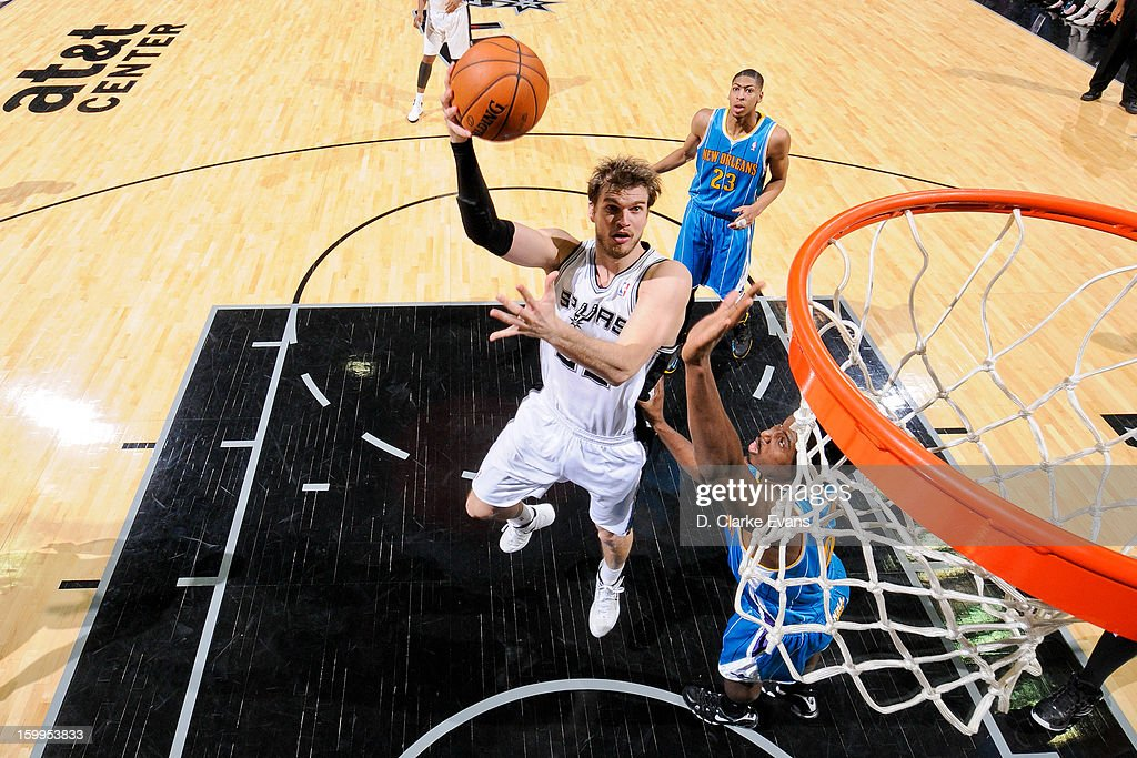 Tiago Splitter #22 of the San Antonio Spurs shoots in the lane against Al-Farouq Aminu #0 of the New Orleans Hornets on January 23, 2013 at the AT&T Center in San Antonio, Texas.