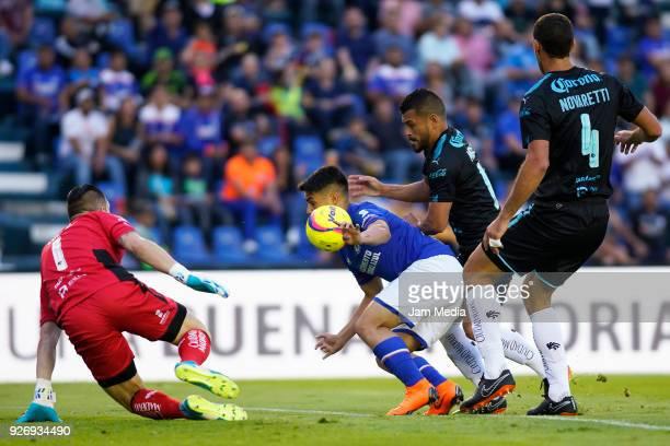Tiago Volpi Miguel Zamudio Diego Novaretti of Queretaro and Felipe Mora of Cruz Azul fight for the ball during the 10th round match between Cruz Azul...