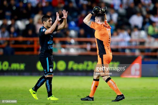 Tiago Volpi of Queretaro celebrates with teammates after scoring the first goal of his team during the 16th round match between Pachuca and Queretaro...