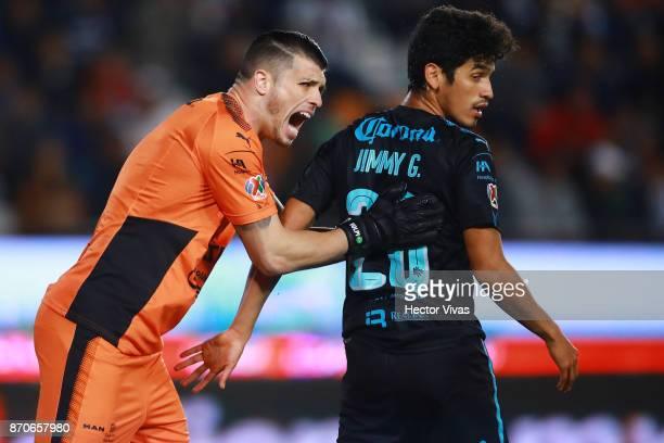 Tiago Volpi of Queretaro gestures with Jaime Gomez of Queretaro during the 16th round match between Pachuca and Queretaro as part of the Torneo...