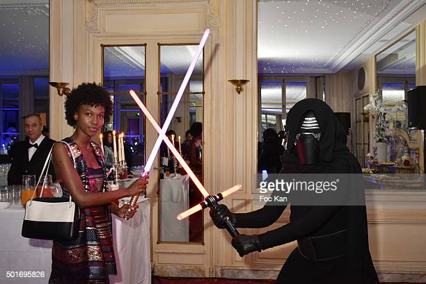 Tiah Beye poses with a 'Dark Vador' during the 'Star Wars Episode VII The Force Awakens' Screening Party Hosted by ST Dupont at the Automobile Club...