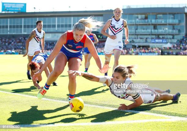 Tiah Haynes of the Dockers is tackled by Katie Brennan of the Bulldogs during the 2018 AFLW Round 01 match between the Western Bulldogs and the...