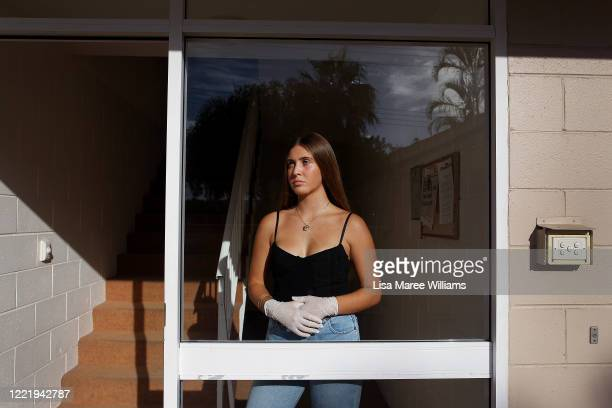 Tiahne O'LoughlinJohnson stands inside the doorway of her home on March 31 2020on the Sunshine Coast Australia Tiahne says she misses spending time...