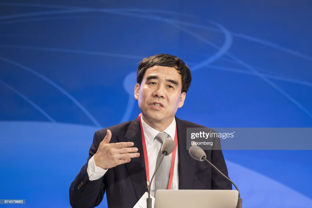 Tian Guoli, chairman of China Construction Bank Corp., speaks during the Lujiazui Forum in Shanghai, China, on Thursday, June 14, 2018. China's central bank is studying policies to boost loans to smaller firms, People's Bank of China Governor Yi Gang said in a speech to the annual forum. Photographer: Qilai Shen/Bloomberg via Getty Images