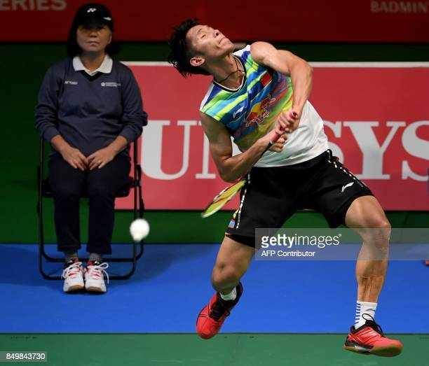 Tian Houwei of China hits a return against Srikanth Kidambi of India during their men's singles first round match at the Japan Open Badminton...