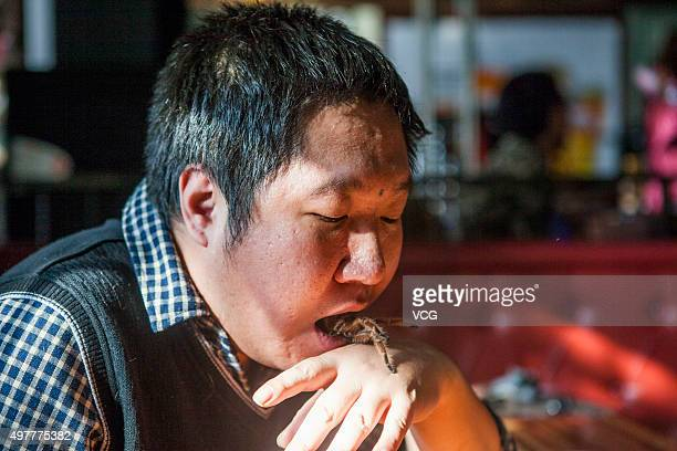Tian Jiashi puts a live spider into his mouth on November 18 2015 in Changchun Jilin Province of China 33yearold dancing teacher Tian Jiashi has been...