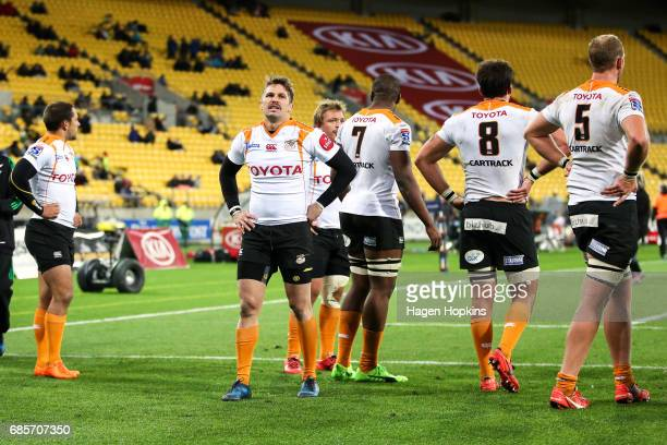 Tian Meyer of the Cheetahs and teammates look dejected after a Hurricanes try during the round 13 Super Rugby match between the Hurricanes and the...
