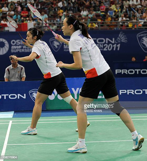 Tian Qing and Zhao Yunlei wait to receive serve against compatriots Yu Yang and Wang Xiaoli during their women's doubles final at the Malaysia Open...