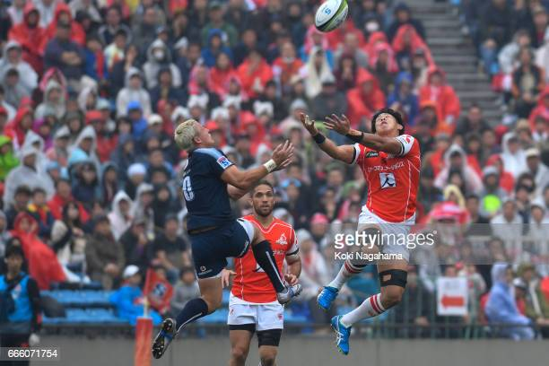 Tian Schoeman and Yoshitaka Tokunaga compete for the ball during the Super Rugby Rd 7 match between Sunwolves v Bulls at Prince Chichibu Memorial...