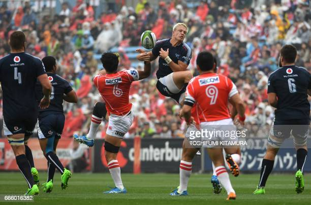 Tian Schoeman of the Bulls and Yoshitaka Tokunaga of the Sunwolves fight for the ball during the Super Rugby match between the Sunwolves of Japan and...
