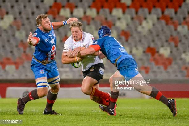 Tian Schoeman of Toyota Cheetahs tackled by Marco van Staden and Duane Vermeulen of Vodacom Bulls during the Super Rugby Unlocked match between the...