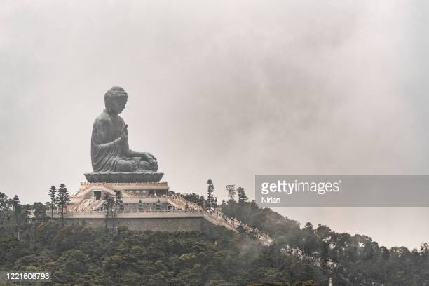 tian tan buddha between clouds - third place stock pictures, royalty-free photos & images