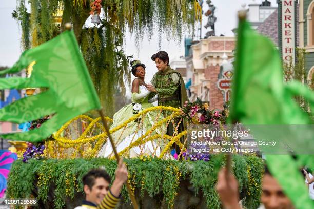 Tiana and Prince Naveen, from Princess and the Frog, during the new Magic Happens Parade on Main Street U.S.A. Inside Disneyland in Anaheim, CA, on...