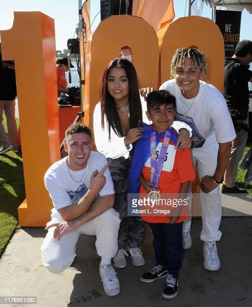 Tiana Kocher and dancers pose with fans at the 19th Annual Strides For Disability 5K Run held at Shoreline Aquatic Park on October 19 2019 in Long...