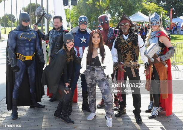 Tiana Kocher poses with cosplayers at the 19th Annual Strides For Disability 5K Run held at Shoreline Aquatic Park on October 19 2019 in Long Beach...