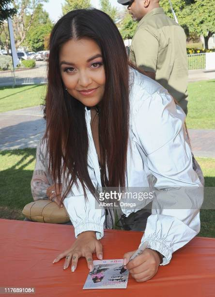 Tiana Kocher signs autographs at the 19th Annual Strides For Disability 5K Run held at Shoreline Aquatic Park on October 19 2019 in Long Beach...