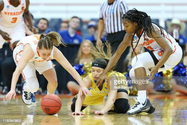 Tiana Mangakahia of the Syracuse Orange Rylie Cascio Jensen of the South Dakota State Jackrabbits and Kiara Lewis of the Syracuse Orange battle for a...