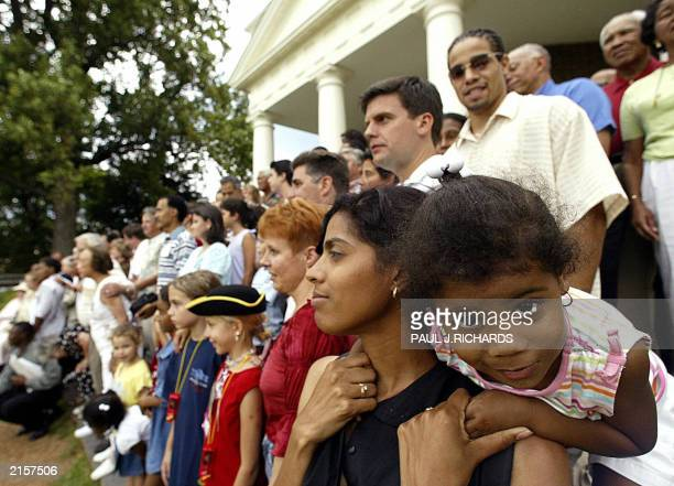 Tiana Norvell 2yrs wiggles around on the shoulders of her mother Monica Steed as they pose for a large family photo with about 150 of the descendants...