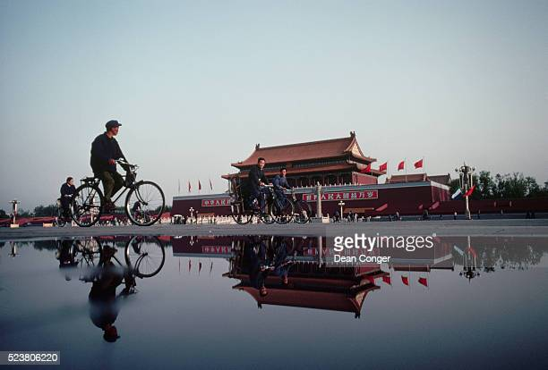 tiananmen and bicyclist - tiananmen square stock pictures, royalty-free photos & images