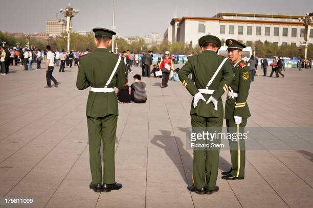 CONTENT] Tiananmen Square Beijing China soldiers Three soldiers uniform military young men Asian rear view Street Photography real people oriental...